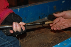 Photo 3- Removing a wooden core from the corer.